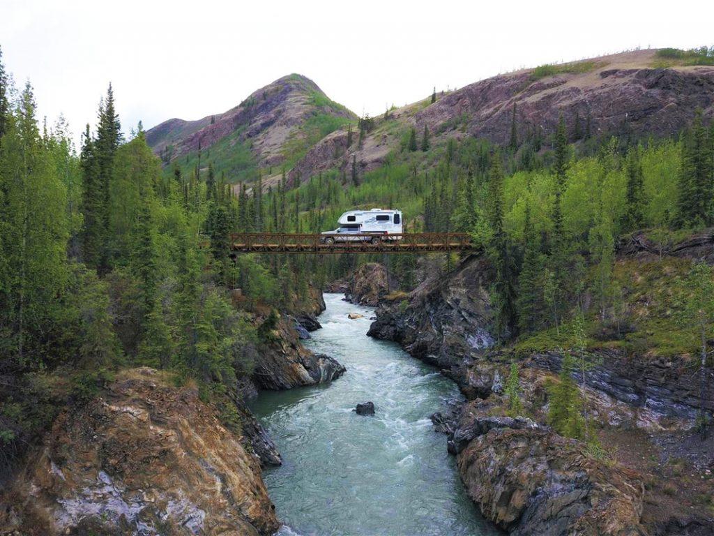truck camper rv on bridge over river