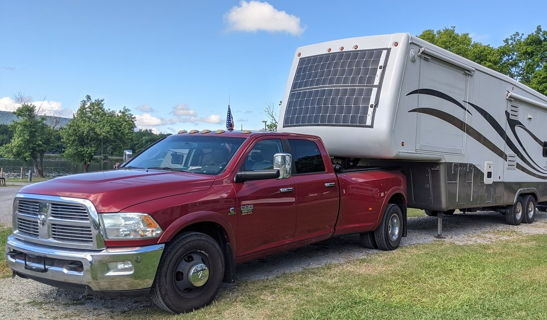 rv with solar panels on front
