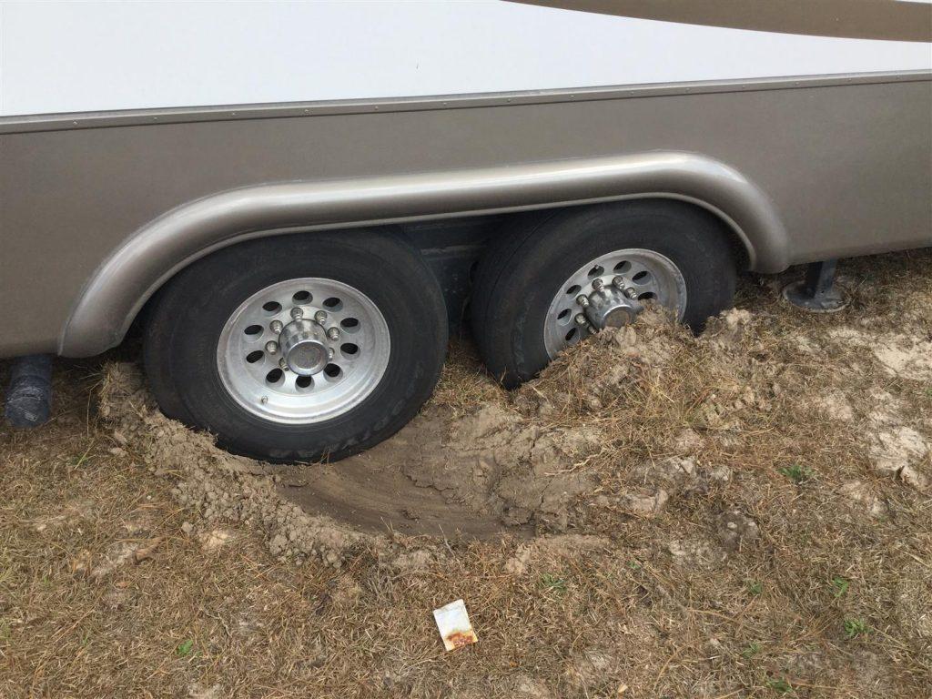fifth wheel stuck in dirt