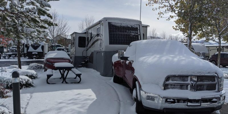 rv skirting on fifth wheel covered in snow