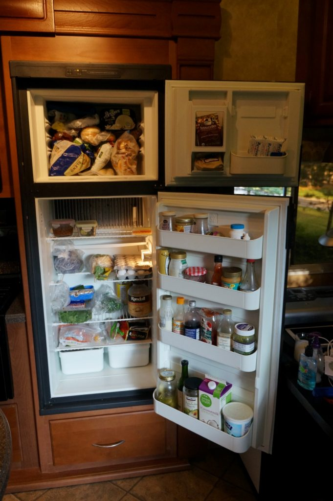 RV fridge open filled with food