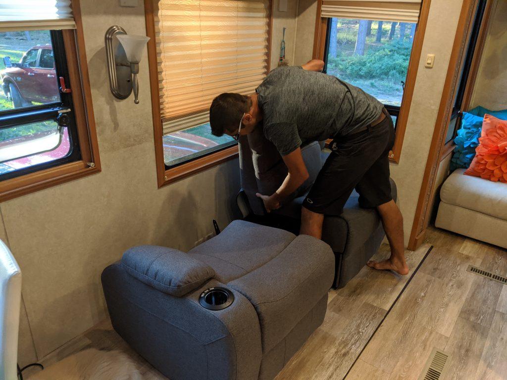 modular wall hugger recliner sofa being assembled in RV