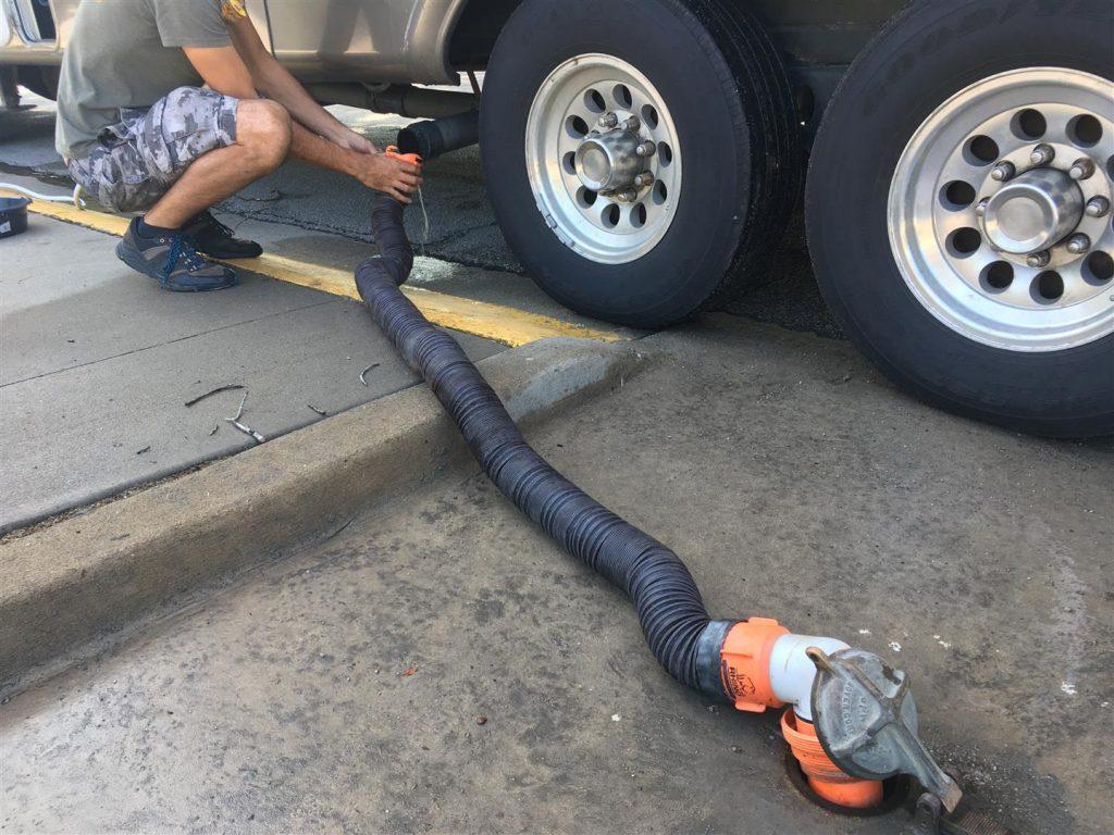 hooking up rv sewer hose at dump station
