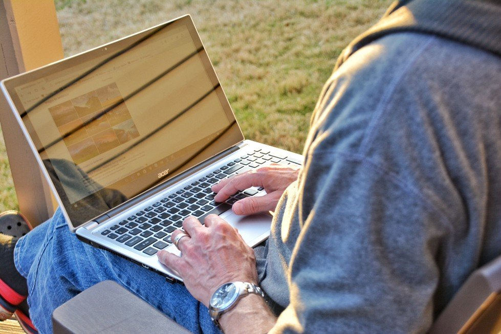 man searching online rv listing websites