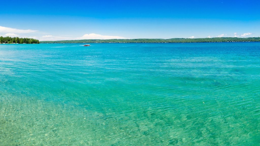 beautiful turquoise color of torch lake in michigan