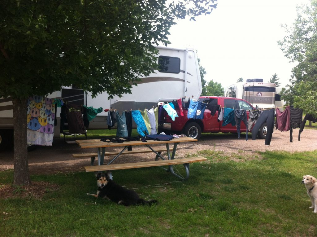 drying rv laundry on clothesline at campsite