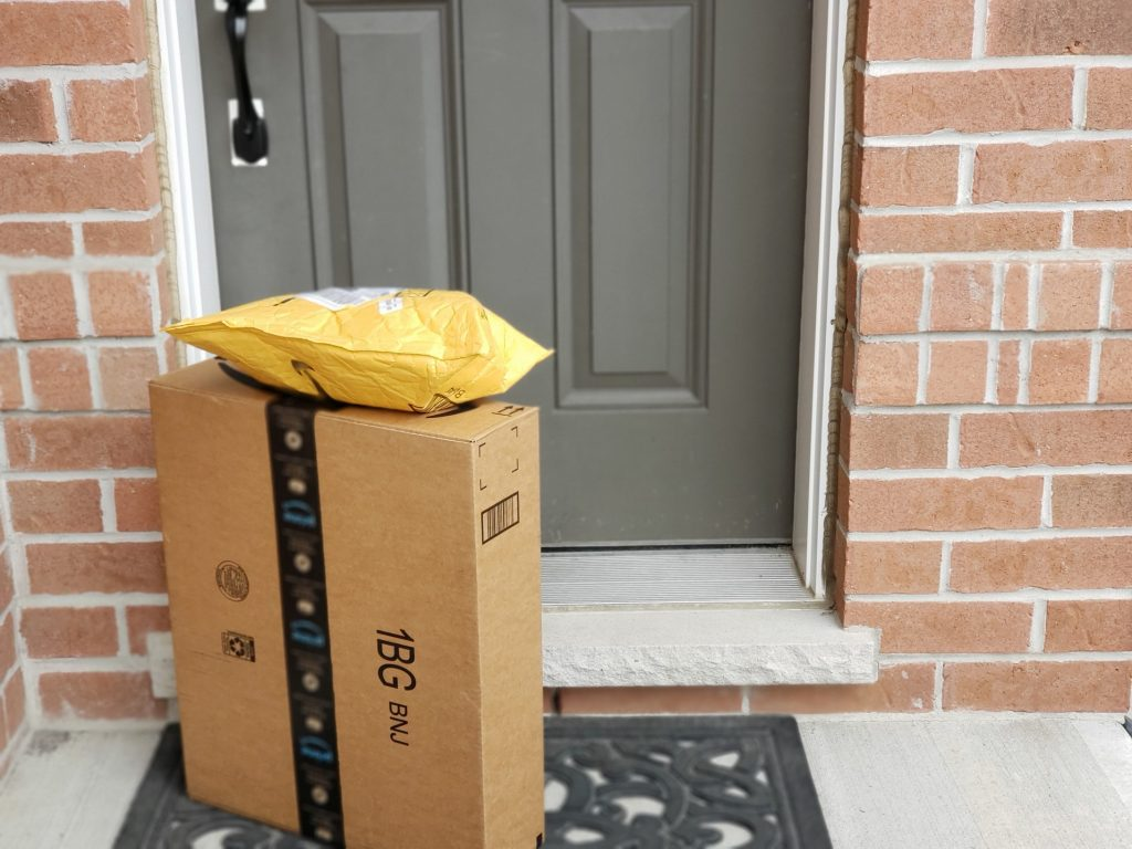 mail and packages on doorstep