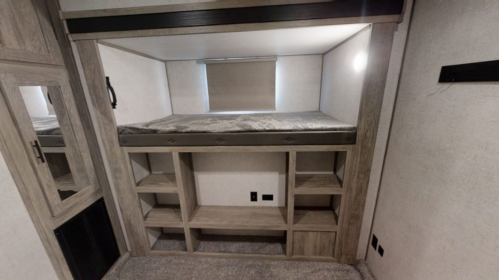 Bunk with storage shelves under the bed