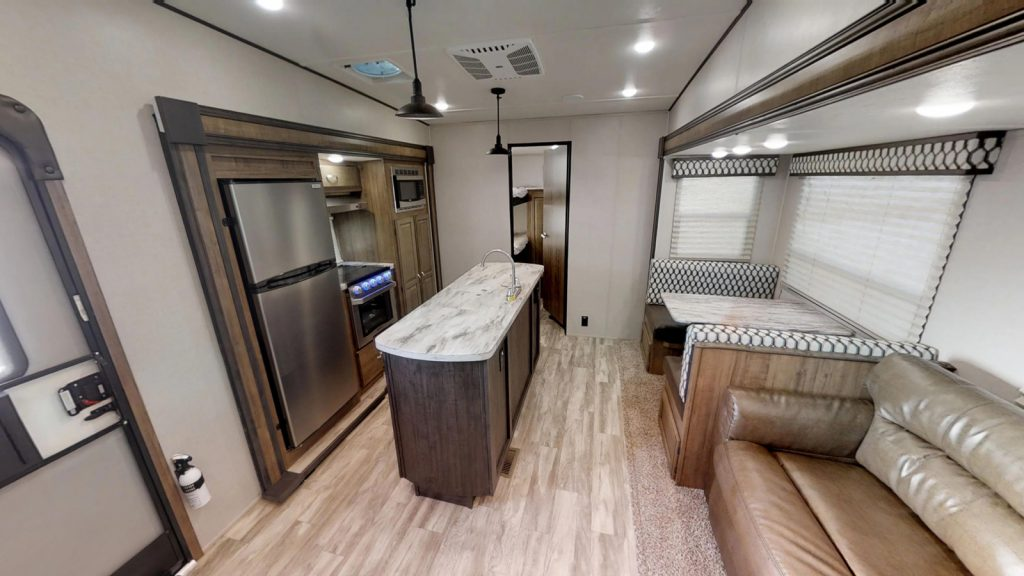 Coachmen Chaparral Lite 29BH kitchen with bunk room in the back.