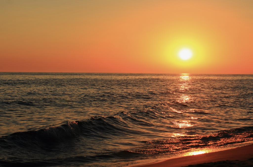beach sunset over lake michigan