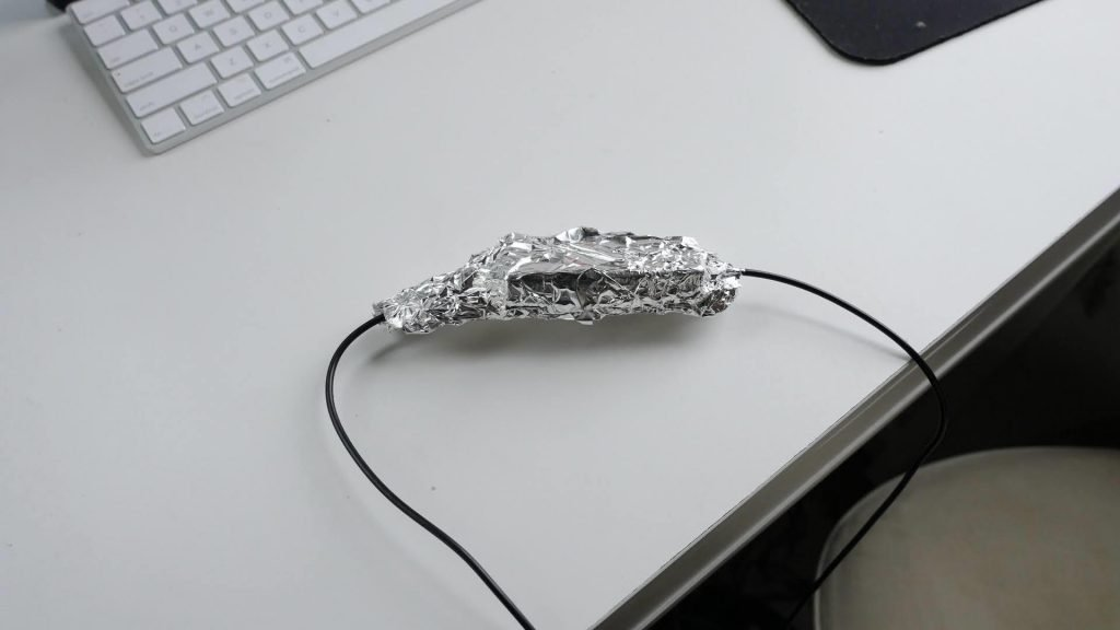 WeBoost internal antenna in aluminum foil to shield it from the booster's external portion