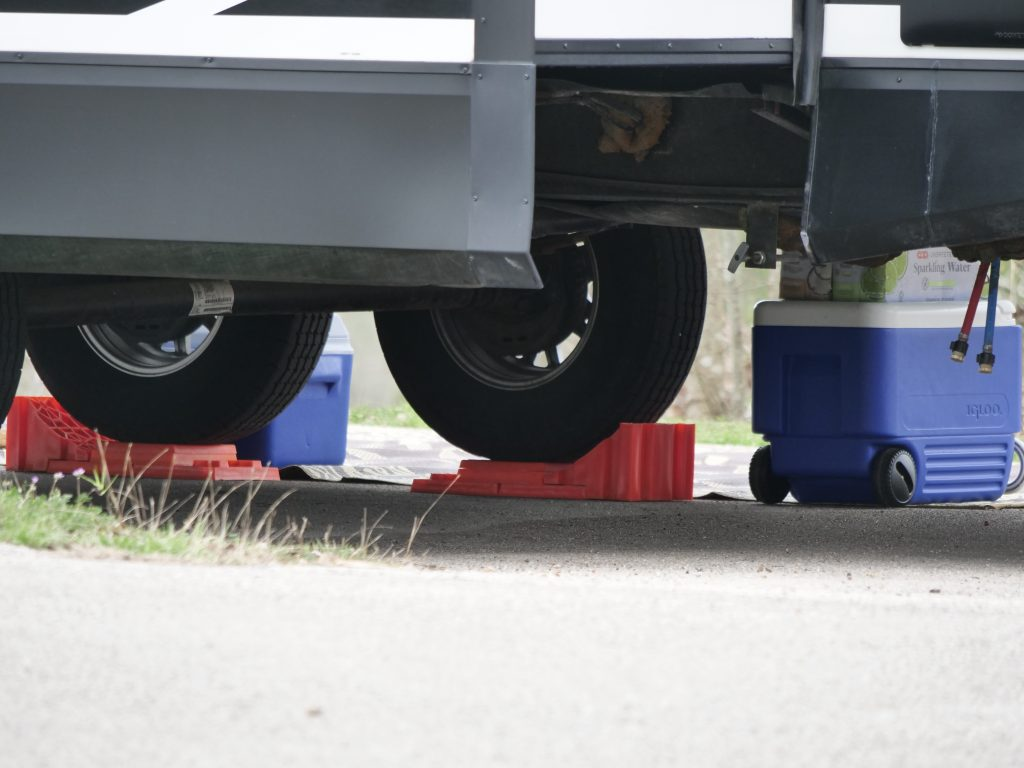 rv raised on one side with levelers