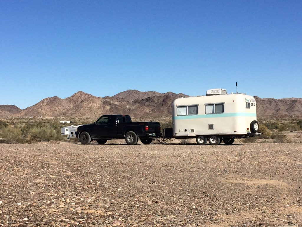 truck towing small travel trailer RV