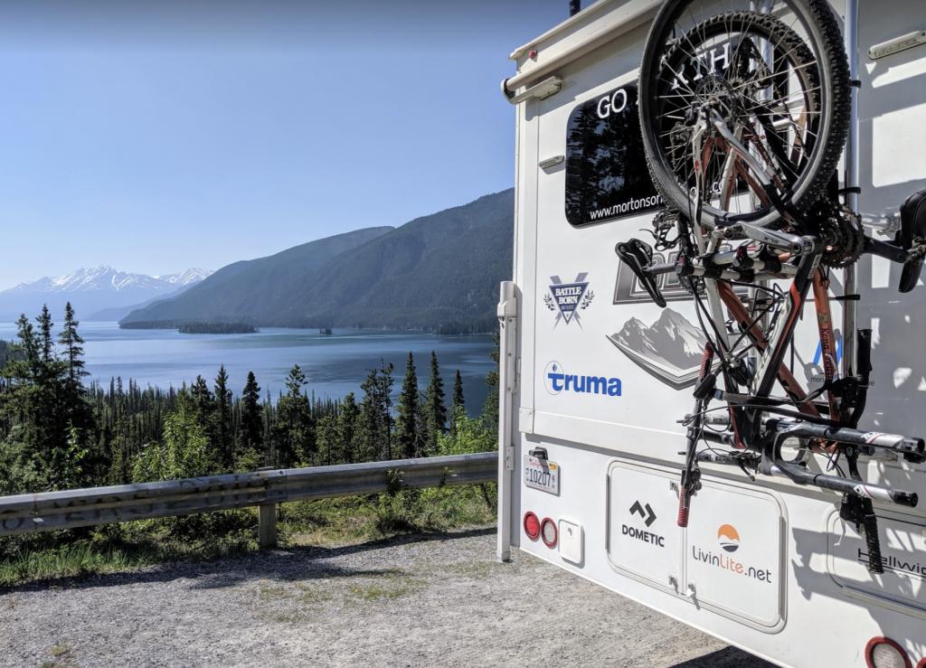 ladder-mounted bike rack on truck camper