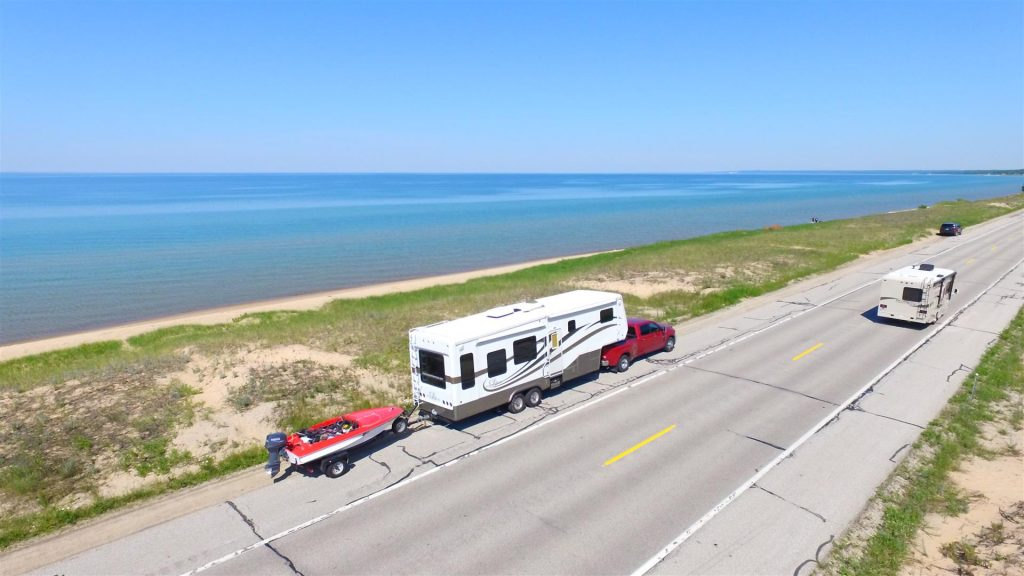triple towing a boat behind a fifth wheel rv trailer
