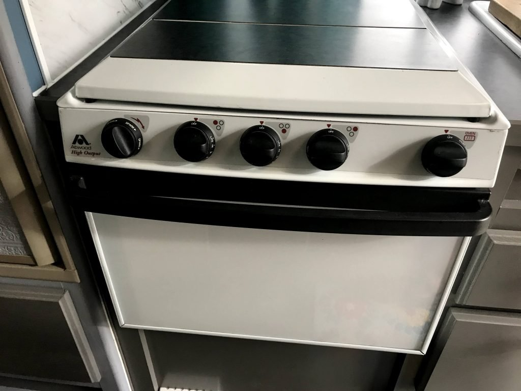 RV stove and oven with stove cover down