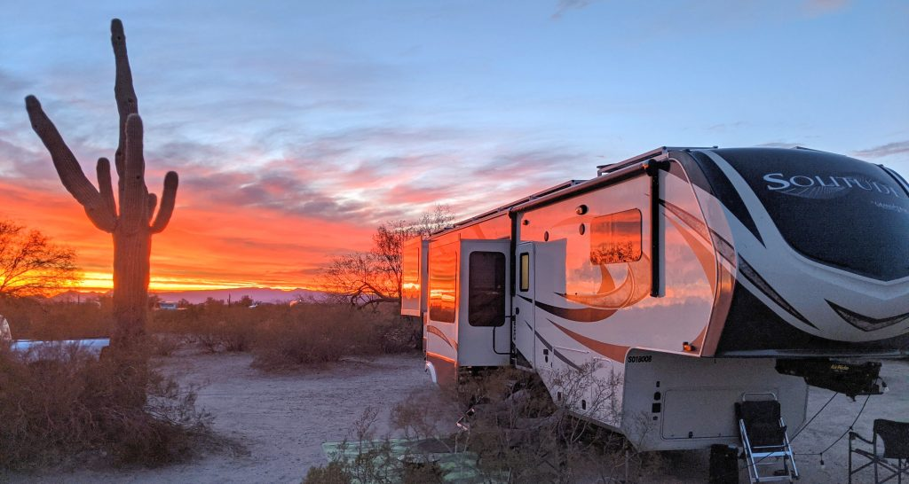 beautiful fifth wheel at sunset with cactus