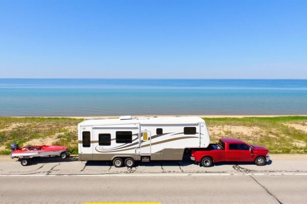 Triple towing a boat behind a fifth wheel