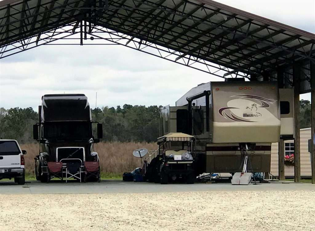 New Horizons 5th Wheel towed by a semi-truck