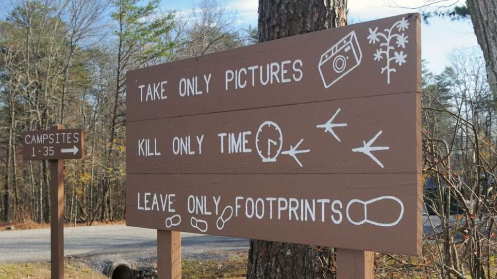 take only pictures campground sign