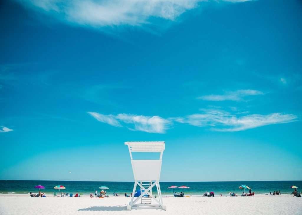 White sandy beach in Gulf Coast of Florida. Lifeguard chair overlooking the beach.