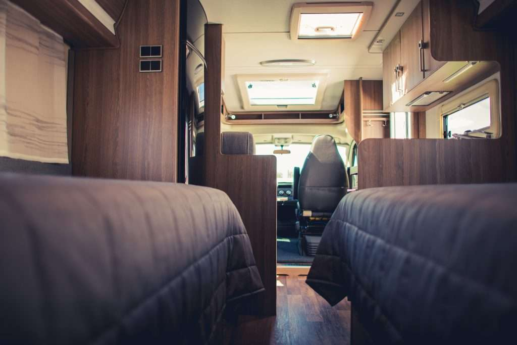 Inside of RV home from bed to front passenger seat.