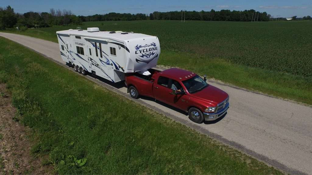 Mortons on the move truck towing 5th wheel.