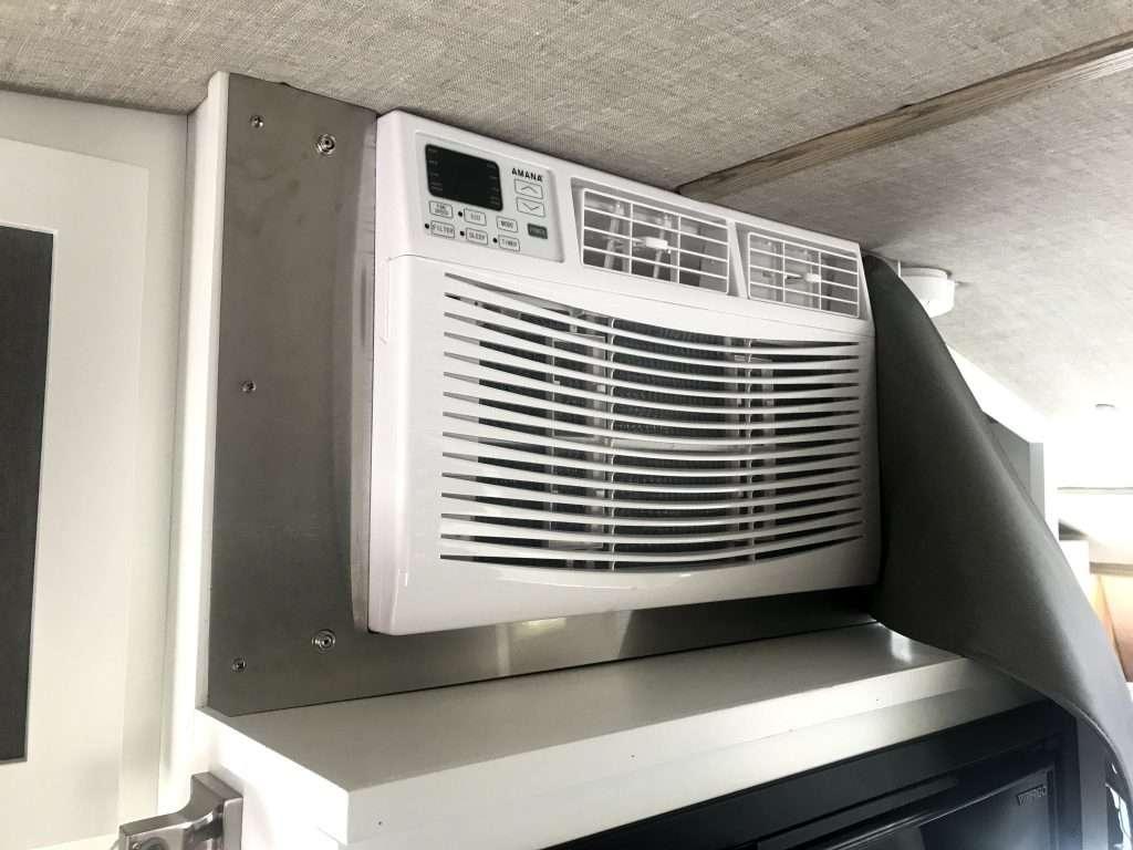 Window AC unit installed in camper wall