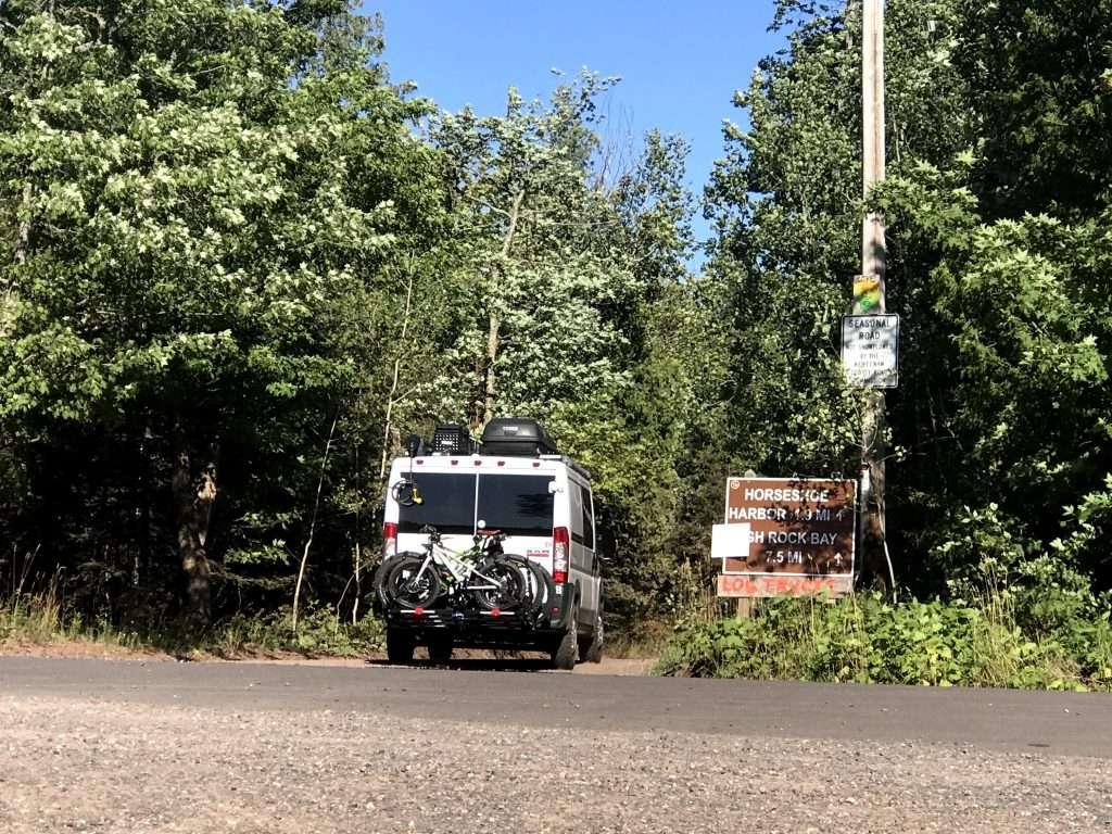 camper van going down a dirt road