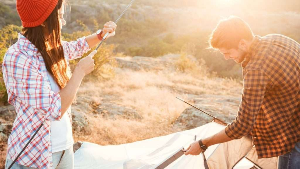 Couple disassembling a tent