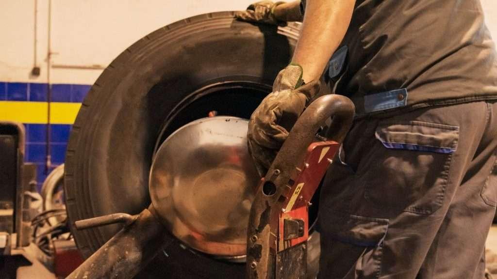 replacing motorhome tire in shop