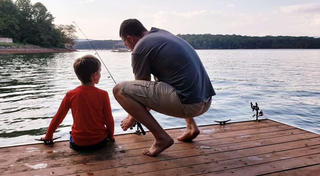 Dad and son fishing together.