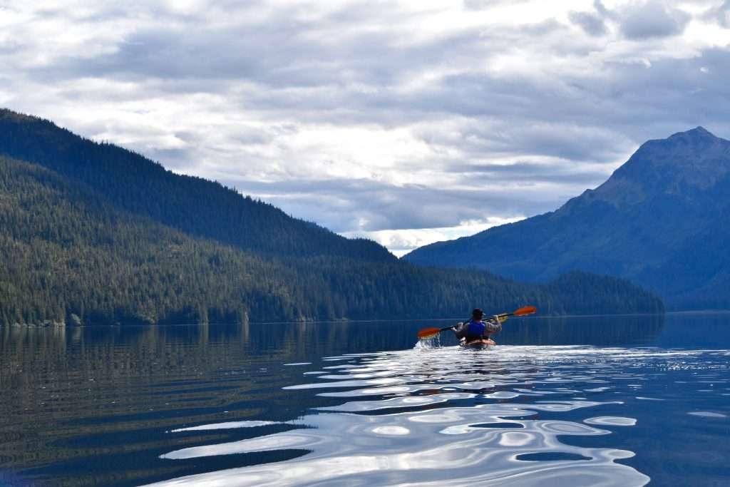 Person kayaking in Alaska.