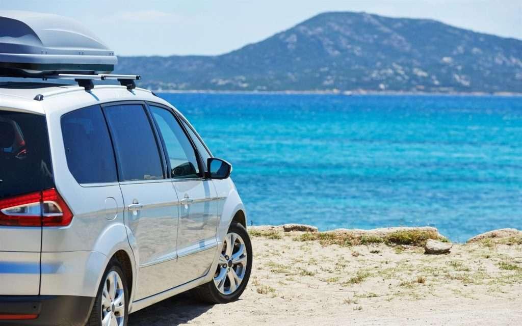 minivan overlooking lake and mountain