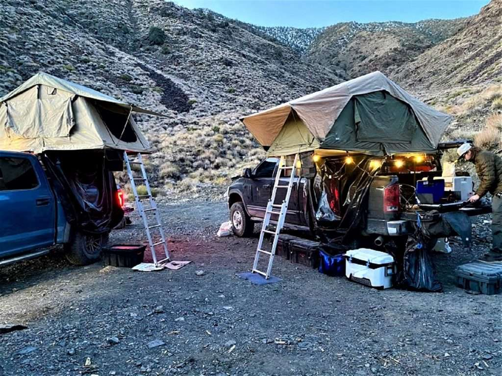 Two overlanding vehicles setting up camp.