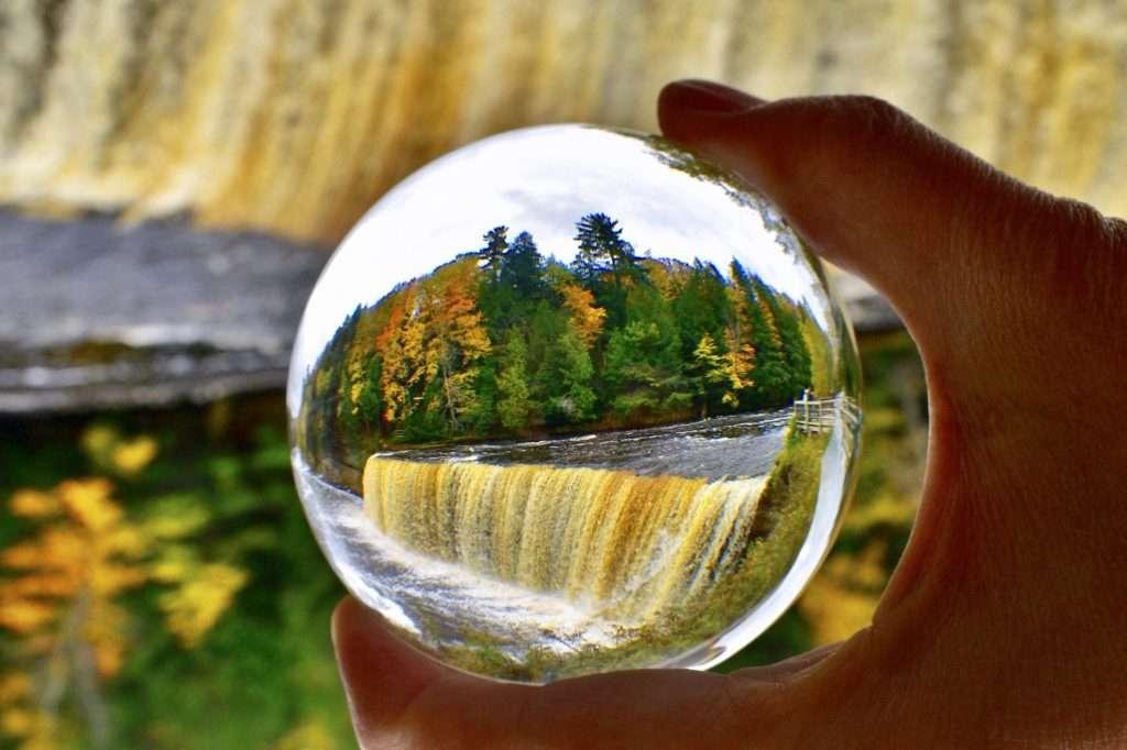 Tahquamenon Falls State Park waterfall through a glass orb.