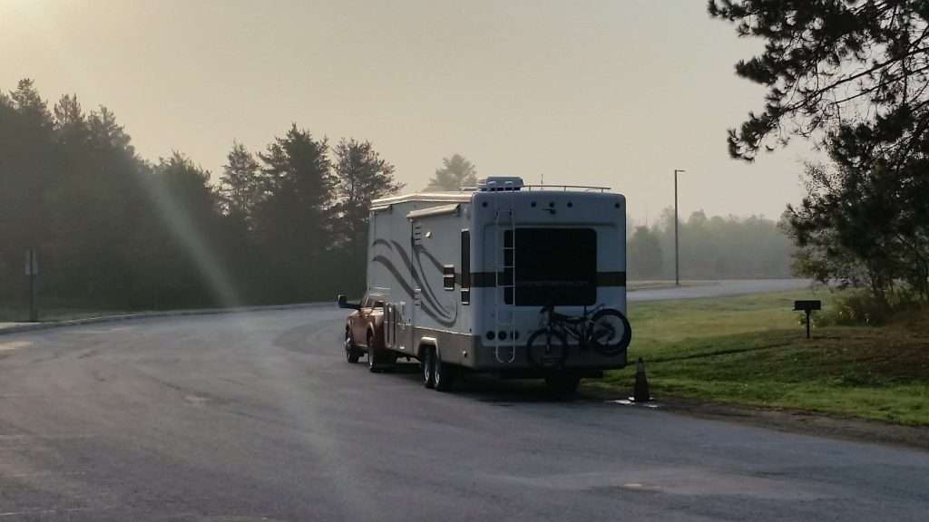Mortons on the Move truck and fifth wheel pulled over on the side of the road.