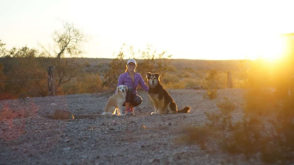Cait in the desert with Mocha and Bella