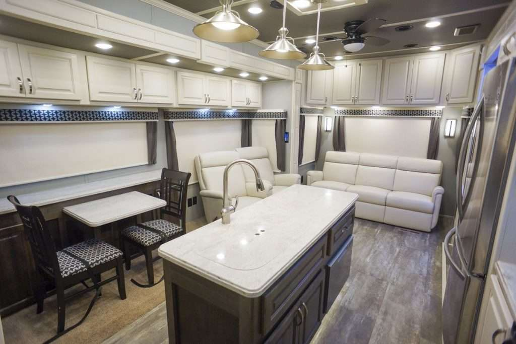 Interior image of kitchen and living room in Luxe RV.
