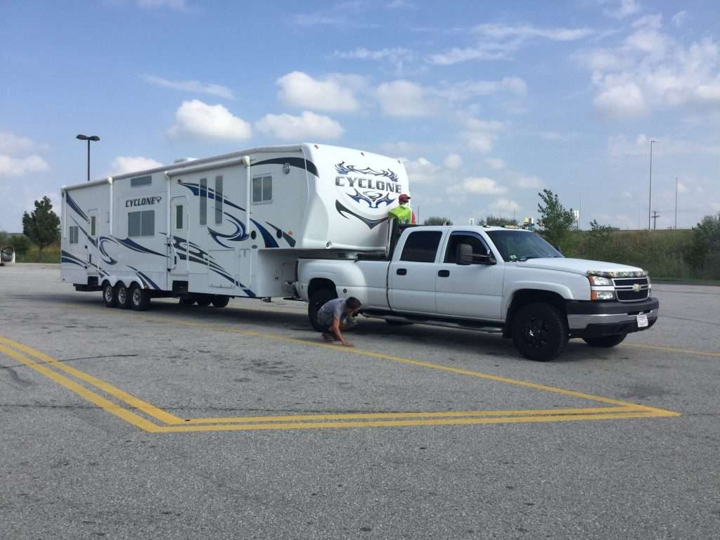 Checking fifth wheel connection to truck while beginning to tow.