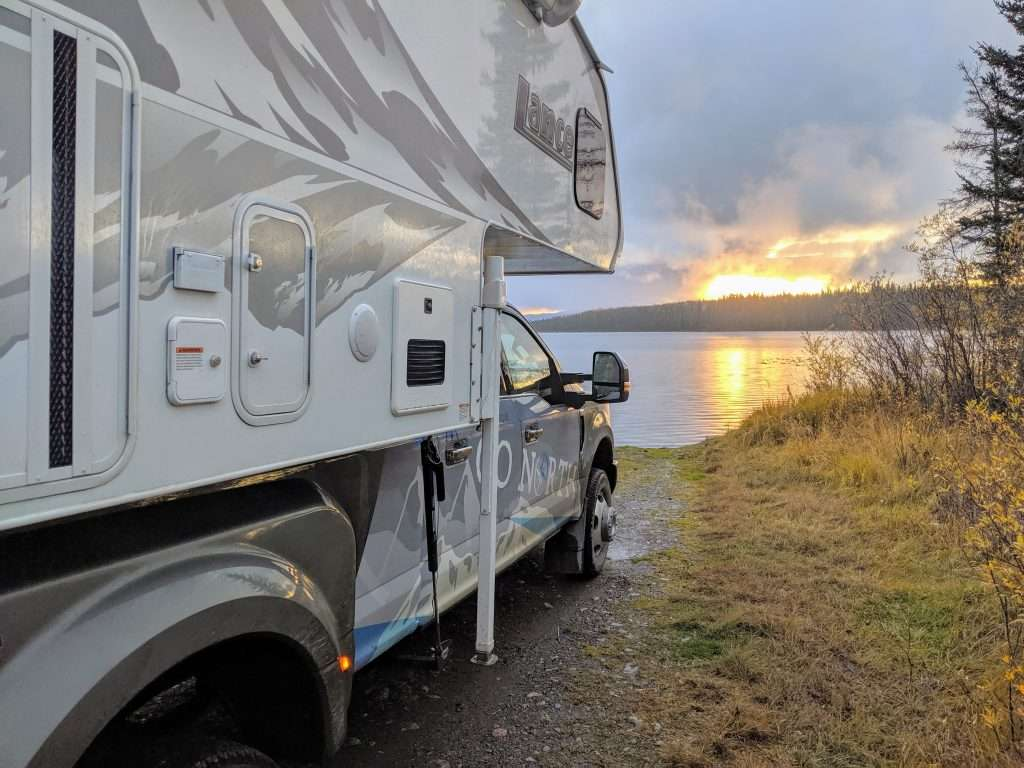 truck camper parked near a lake