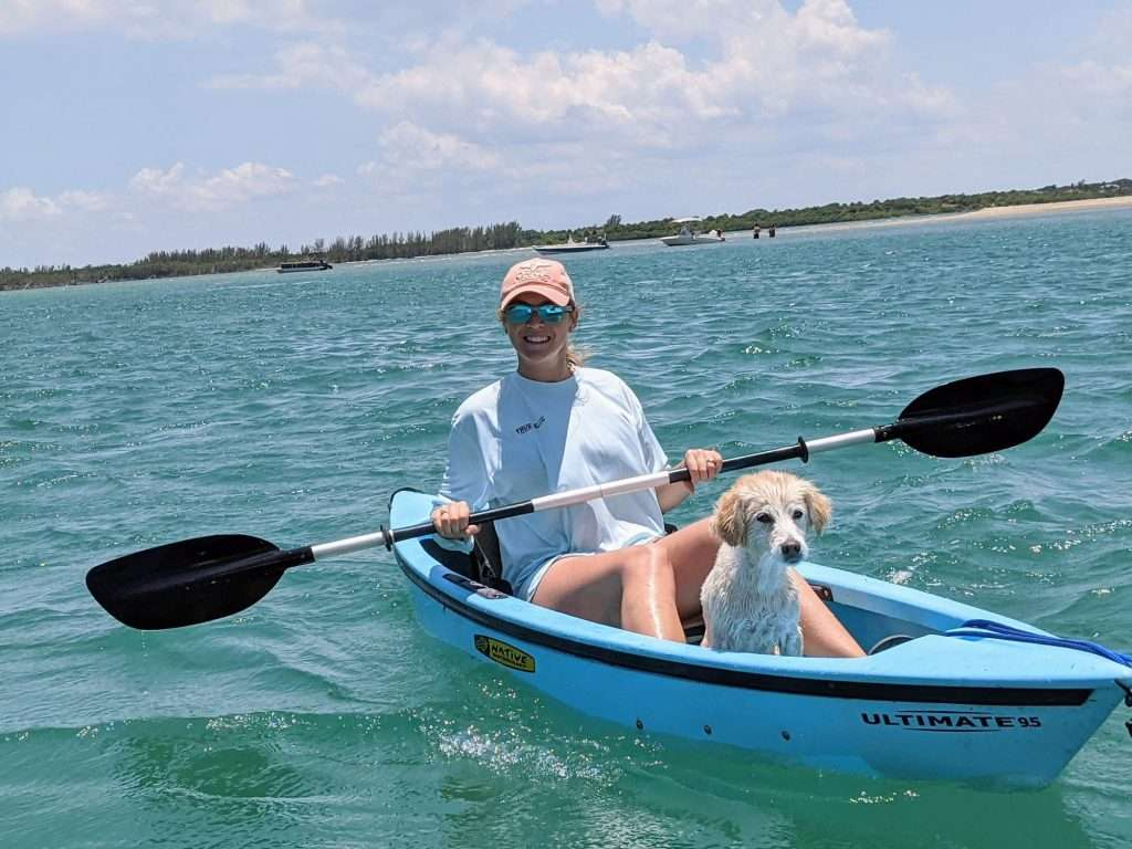 caitlin morton kayaking with dog bella