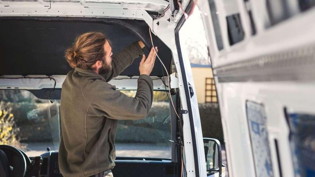 Man working on Sprinter van