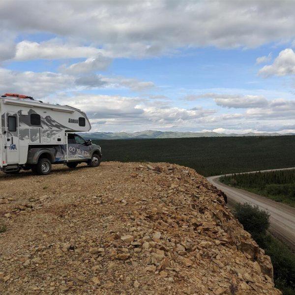 Truck camper overlooking dirt road