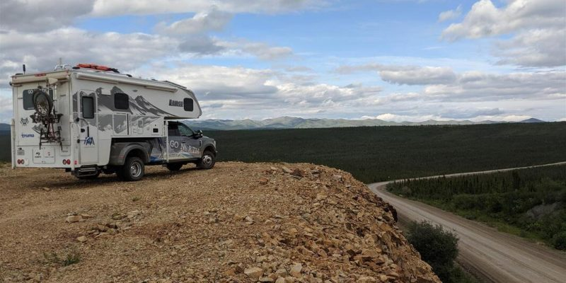Truck camper overlooking dirt road