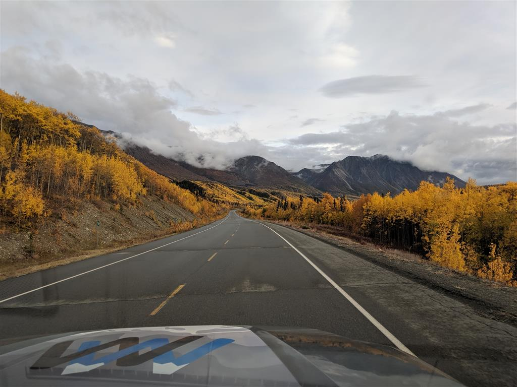 driving through kluane national park in fall