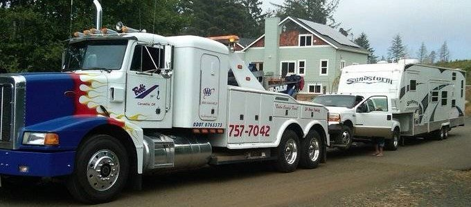 rv being towed by tow truck
